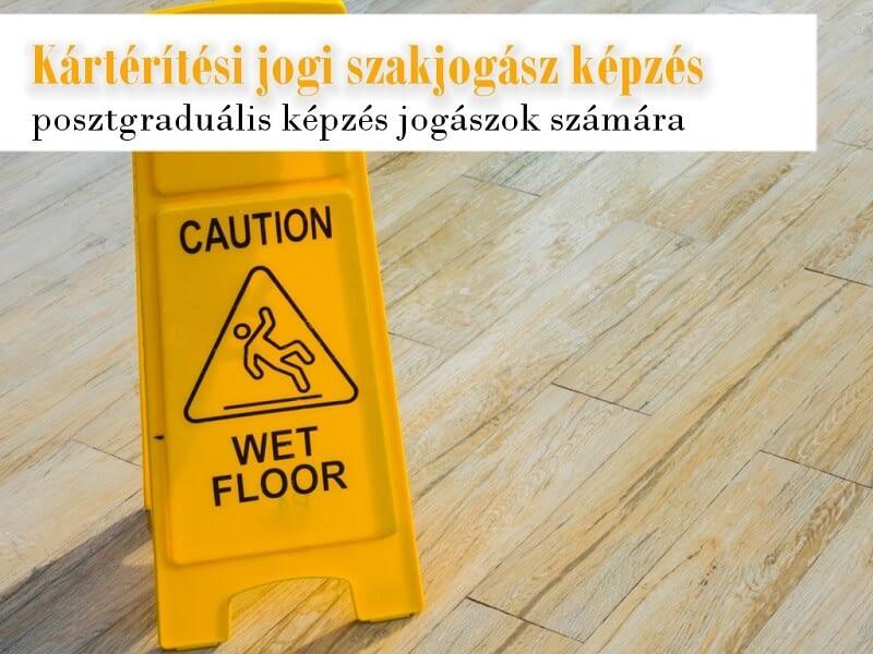 A képen egy felmosás utáni figyelmeztető tábla látható